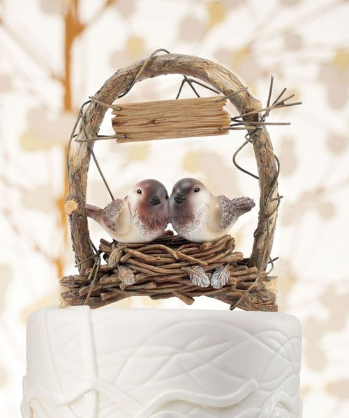 <p> Nestled under a homespun archway, this adorable Love Bird pair snuggles in close. Ideal for nature lovers at heart, this whimsical Cake Topper adds a touch of fun and rustic charm to any wedding style.<br /> <br /> Product Material:Sculpture Poly Resin</p>