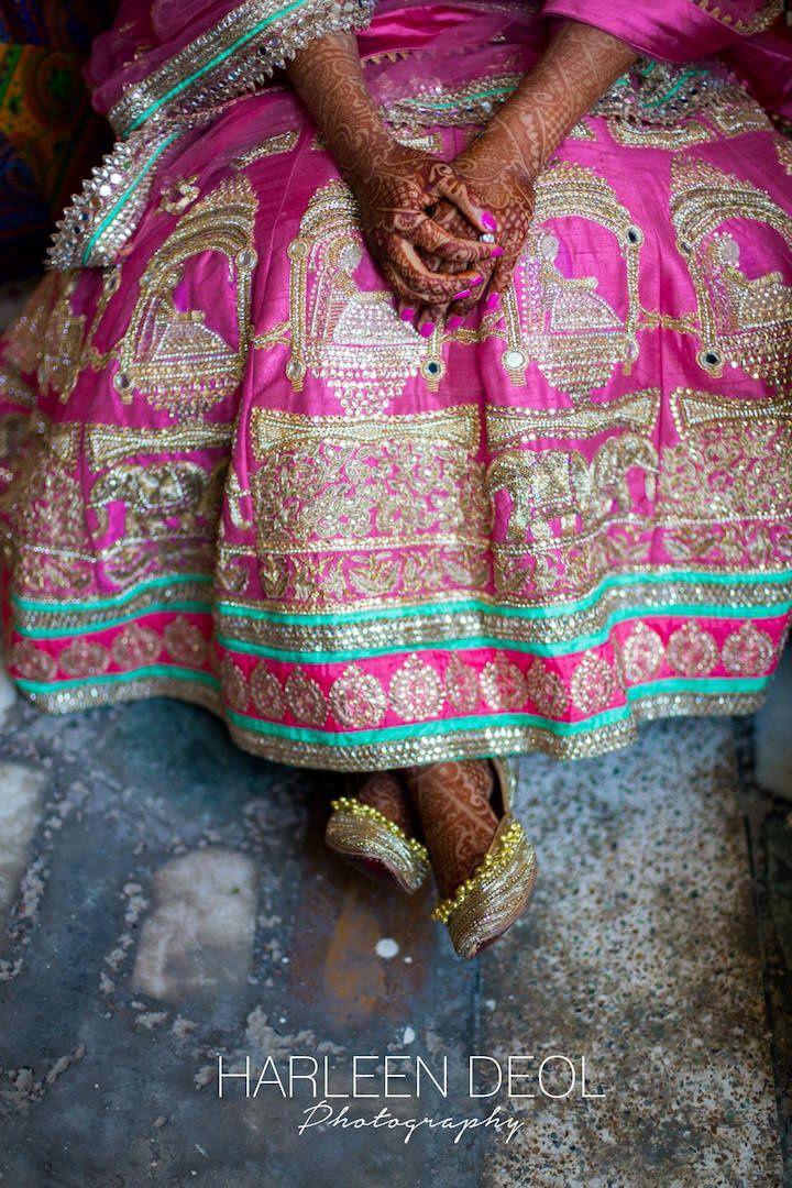Bridal Details - Pink Bridal Lehenga with Aquamarine Detailing | WedMeGood | Pink SIlk Lehenga with Gold and Silver Embroidery and a Palki Design, Golden Juttis with Ghungroo #wedmegood #indianbride #indianwedding #palki