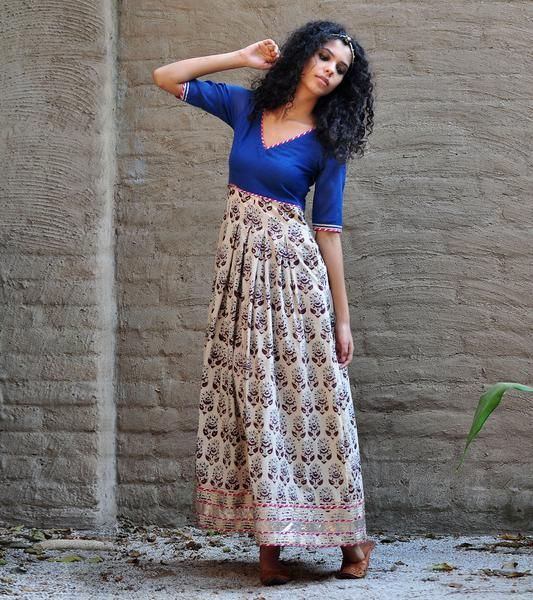 Our classic Royal blue paisley print gown is crafted in 100% cotton fabric that is block printed using all natural dyes. It features a fitted torso and a box pl