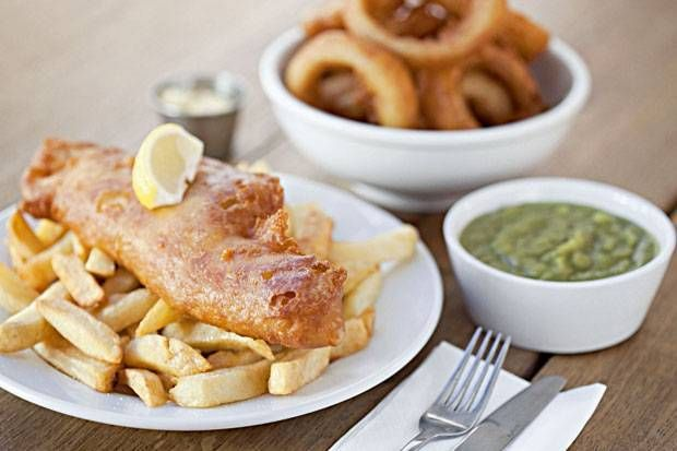 World famous Fish And Chips. Battered fish (usually cod or haddock) served with chips and often mushy peas.