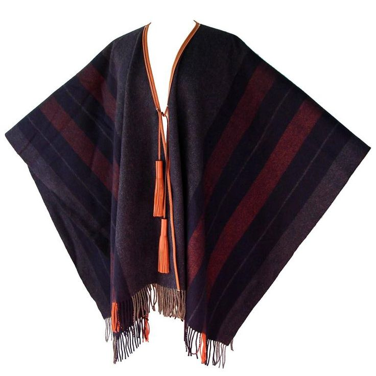 Hermes Cashmere Wool Fringed Rocabar Poncho with Leather Tassels New  | From a collection of rare vintage coats and outerwear at https://www.1stdibs.com/fashion/clothing/coats-outerwear/