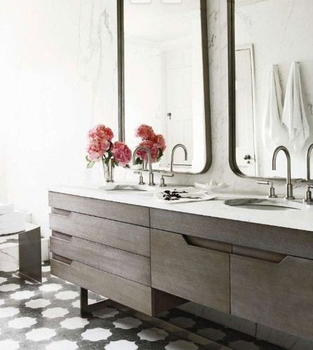 inspiration a revived townhouse in london bathroom carrara marble slab walls and vanity with undermount sink gunmetal mirrors dornbracht fixtures
