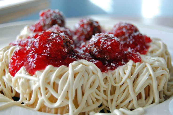 """Make """"Spaghetti & Meatballs"""" for dessert!! This is actually a concoction of cupcakes, frosting, strawberry preserves and chocolate hazelnut truffles!"""