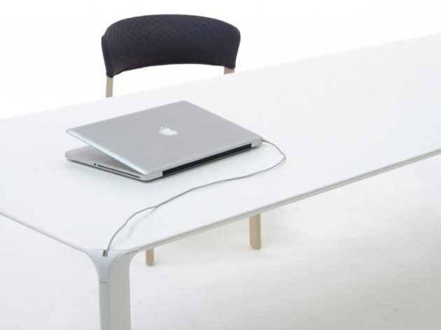 Steel table. An unconventional table that combines 2 materials; steel and (solid)wood. 2.5mm sheet metal with a powder-coating finish forms the basis of the table. The top can (optional) be finished with a layer of 2.5mm semi-solid wood. Together with the option of legs in solid wood, this creates a total of 4 possible combinations. The table has an industrial feel yet it also has the refined craftsmanship and elegant finish traditionally associated with Arco.