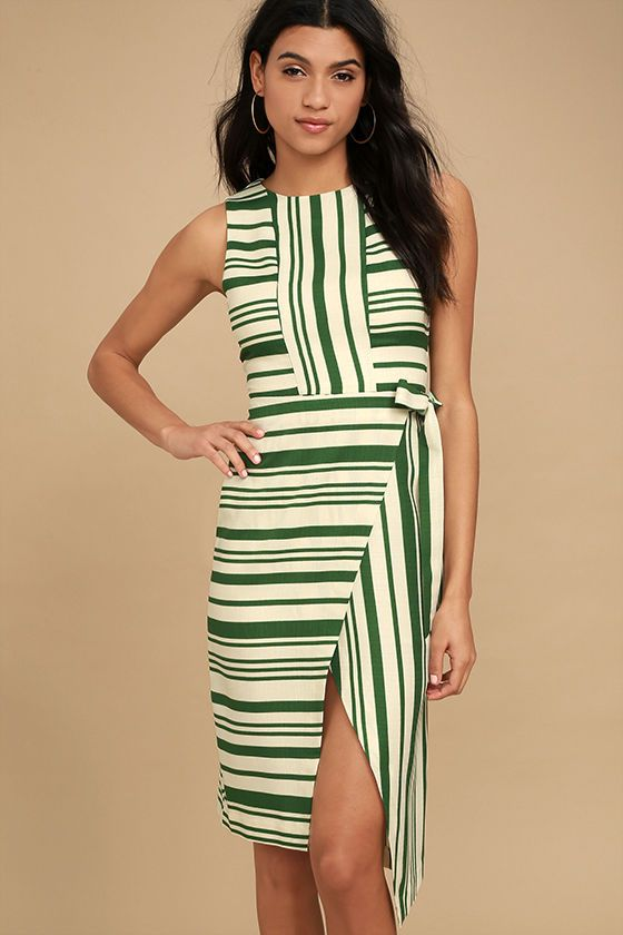 You'll fall fast in love with the easy going style of the J.O.A. Faustina Green Striped Midi Wrap Dress! Green and cream striped woven fabric shapes this lovely midi dress with a rounded neckline, sleeveless bodice, and wrap skirt with a tying waist sash. Hidden back zipper/clasp.
