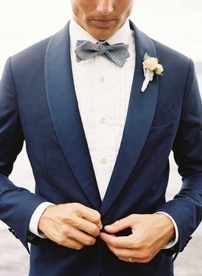 Navy Blue Suit with Blue-Grey Bow Tie Photography: Tec Petaja Read More: http://www.insideweddings.com/weddings/childhood-friends-celebrate-wedding-at-marriott-familys-lake-house/866/