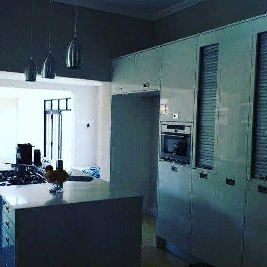 White higloss  and quartz kitchen done by us