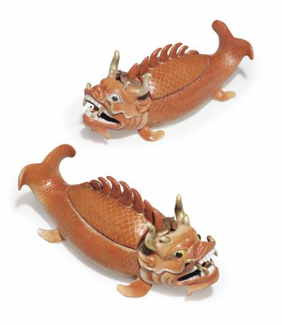 A RARE PAIR OF CHINESE EXPORT PORCELAIN DRAGON CARP TUREENS AND COVERS  QIANLONG PERIOD  Each modeled swimming with upturned tail, its head with gilt tentacles and gilt horns enclosing crossed tufts of brown hair, a row of spiny fins on its back serving as a handle for the cover 8¼ in. (21 cm.) long.