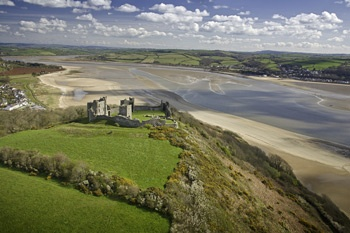 Llansteffan Castle, Carmarthenshire. Carmarthenshire is a county steeped in Arthurian legend. Visit one of many castles such as medieval Kidwelly, Laugharne, Dinefwr or Carreg Cennen.