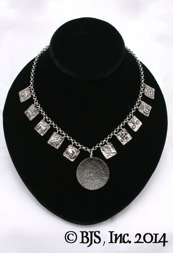 Atticus' Necklace from The Iron Druid Chronicles by Kevin Hearne.