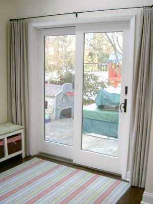 sliding doors need curtains too rod placement should be higher tho sliding door window