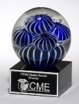 Art glass award globe with blue and white sea anemone design on black glass base. Laser engravable aluminum plate. #art #glass #award #blue #sea
