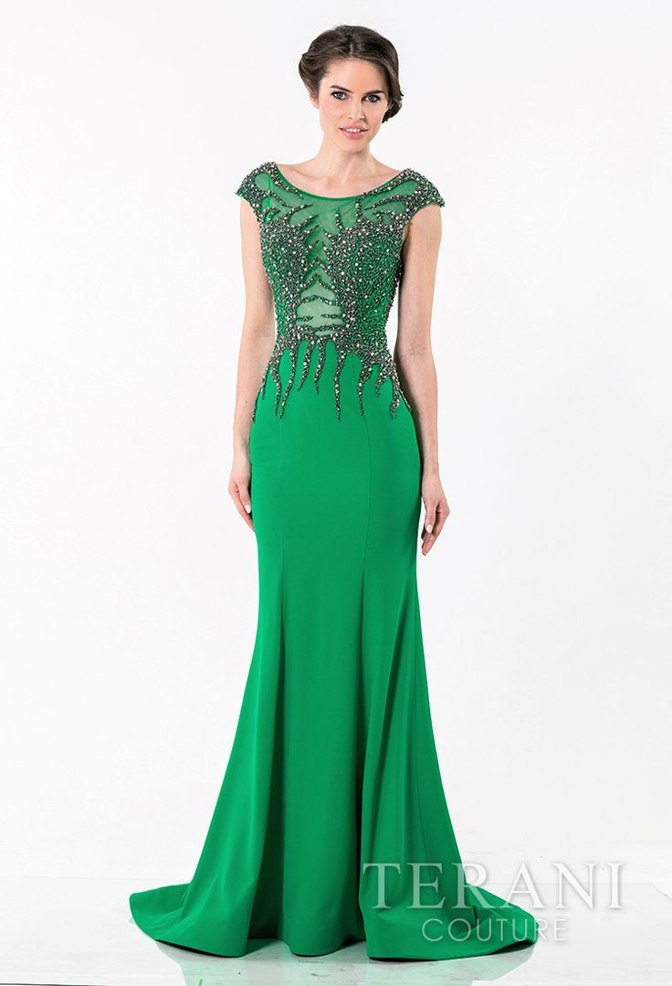 crepe   evening gown with dramatic branching embellishment covering the bust, cap   sleeves, and continuing onto sheer back. The dress is finished with a sheer,   deep neckline and a trumpet skirt.