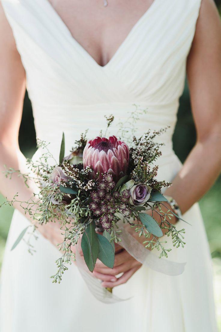 Wedding Bouquet - Giant Protea - http://www.StyleMePretty.com/southeast-weddings/2014/03/26/barn-wedding-at-high-point-farms/ John Shim Photography - johnshim.com | Floral Design: JenniferLaraia.com