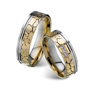 Modele verighete CORIOLAN V605    Verighete din aur galben si aur alb      Latime: 5.75 mm (min 4.75 mm - max 8 mm)     Carate diamante: 0.075 Ct     Greutate aprox.: 12.2 gr/pereche     Timp de livrare: 2 saptamani  Pret: 3700 - 4400 RON  Pretul este pentru o pereche de verighete din aur 14K cu diamant si este variabil in functie de marimi. Modelul poate fi comandat pe culorile dorite, deasemenea si in aur de 18K.