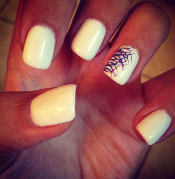White summer nails with blue, light purple, and silver glitter design