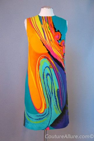 1960s cotton psychedelic shift dress.    Love this! I would belt it and throw on a cardigan.