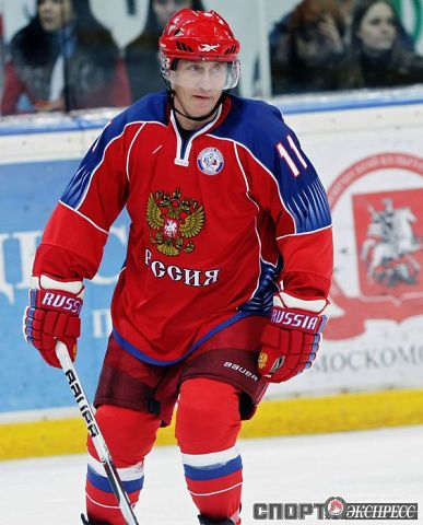 Vladimir Putin and he plays hockey! Is there anything this man does not do; besides me!?