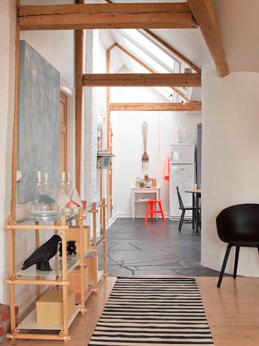 Light, blackboards, random coloured chairs and of course a splash of exposed beams.