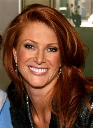 Angie Everhart...my hairdresser is encouraging me to try this color. Says it will look great with my fair skin & blue/grey eyes. I'm not totally sold on the idea because I know red color requires a lot of upkeep. Her color is gorgeous though- I love the richness of it.