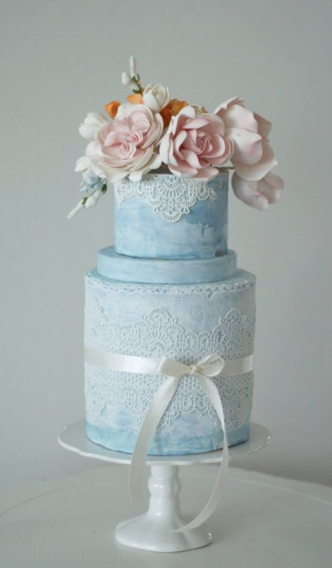 Featured Cake: The Cocoa Cakery; Lace detailed blue wedding cake idea.