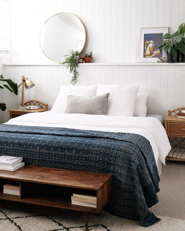 Chic boho coastal home tour. Bedroom with full length half height wall shelf for…