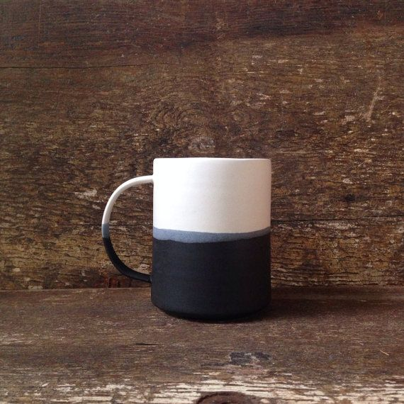 handmade Danish Color-blocked mug in matte black + glossy white. Paper and Clay Studio