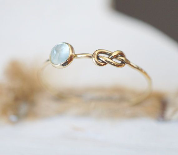 Aquamarine Ring, Rose cut Ring, Infinity Knot Ring, Stacking Ring, Infinity Ring, Celtic Knot Ring, Rose Gold Ring, Yellow Gold Ring, Stack  This listing is for a handmade 14k Gold Ring featuring a pale-blue rose-cut Aquamarine. This lovely natural Gemstone is sure an eye catcher and can be stacked, layered, gifted or kept.  I can make this ring in 14k White Gold, 14k Rose Gold or 14k Yellow Gold. The ring pictured is made from 14k Yellow Gold.  ➼ 4mm rose-cut Aquamarine ➼ set in recycled…