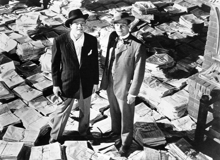"""Relaxed Suiting: Orson Welles and Joseph Cotten, pictured left to right, in the 1941 classic Citizen Kane. """"Following the death of a publishing tycoon, news reporters scramble to discover the meaning of his final utterance."""""""