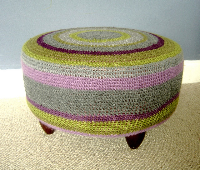dreadful 80's pouffe recovered in a big, stripy crochet coat :-)