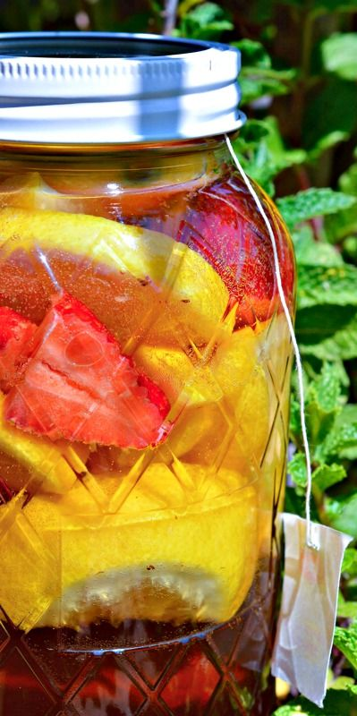 Strawberry Lemonade Sun Tea Recipe _ The perfect summertime beverage. A naturally fruit flavored tea! Awesomeness! This was the best tea I have ever had! The lemon & strawberry flavors really shine!