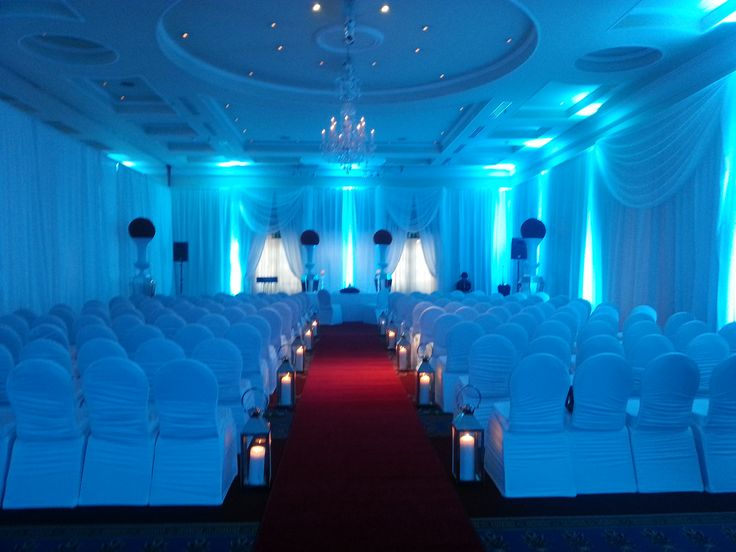 The white draping and cool blue lighting create a very unique look for this wedding ceremony.Visit www.gotchacovered.ie for more information.