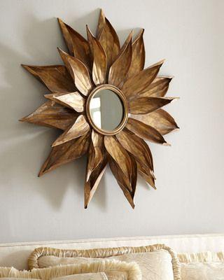 mirror, framed by leafs
