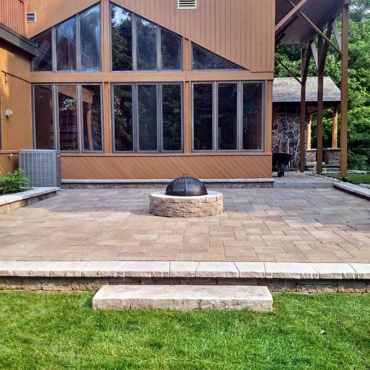 Peaceful moments of reflection star gazing deep talks belly laughs & s'mores are some of my favourite things that happen around a fire pit. Bring the family together this summer with your own outdoor space. Contact us today!  #greenscapespropertyservices  #sundayvibes #sundayfunday #sittingaroundthefire #firepit #firefeature #patio #techobloc #techo #landscaping #landscapedesign #outdoorliving #outdoorspace #summer #plannow