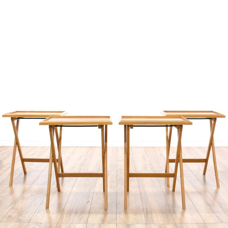 """This set of """"Dolphin"""" TV trays is featured in a solid teak wood with a glossy finish. Each mid-century modern style side table has criss-cross legs, a tray top and clean, streamlined design. Classy and classic set that's also perfect as laptop stands! #midcenturymodern #tables #endtable #sandiegovintage #vintagefurniture"""