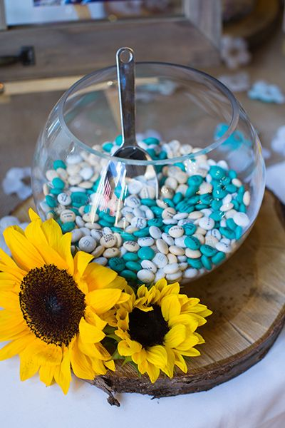 Fill a fishbowl with personalized M&Ms that reflect your wedding colors.