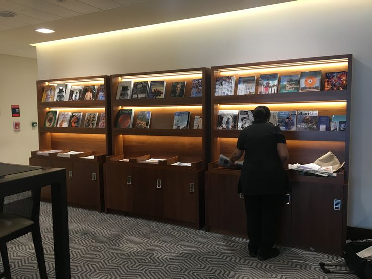 Huge magazine rack full of current Singapore publications for members to read at their leisure