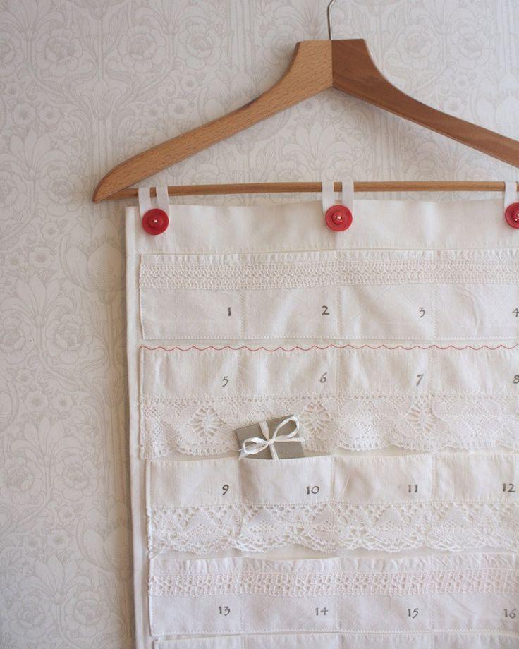 eco friendly christmas calendar, white & red. €65,00, via Etsy.