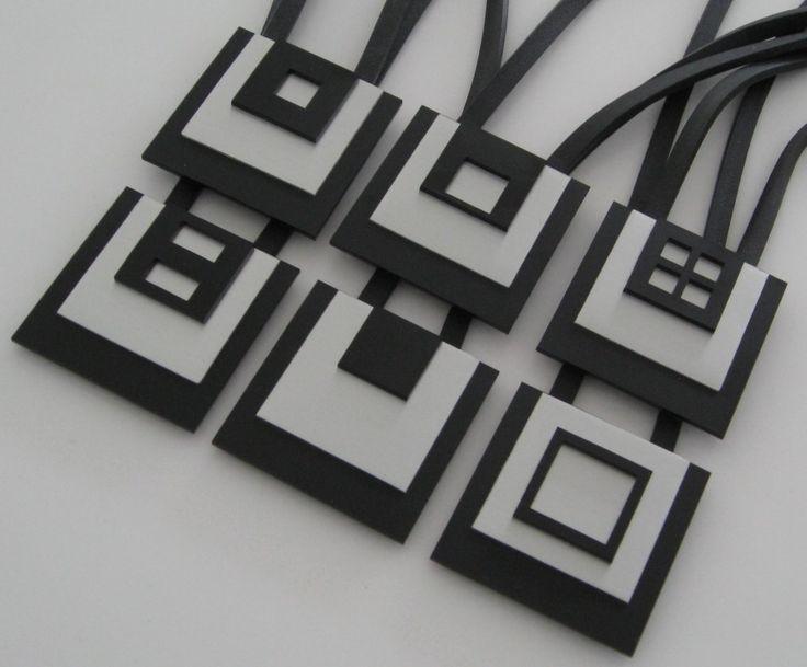 Halsband, aluminium, plexiglas, gummilänk. Necklace, aluminium, plexiglass, rubber cord