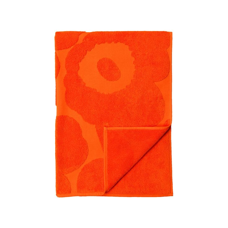Express your love for Maija Isola's poppy print in a way that feels soft and subtle. The 1964 Unikko pattern on this orange bath towel is revealed purely through embossment of the petals, stems and cen