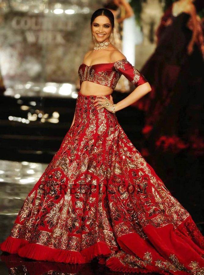 Deepika in Manish Malhotra embellished off-shoulder lehenga at India Couture Week 2016. She looked beautiful.