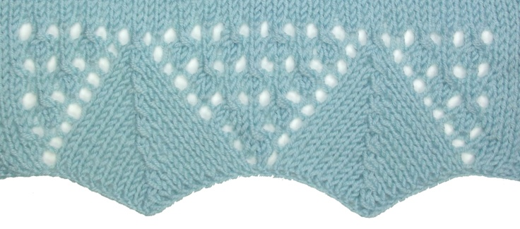 Spanish Lace Border is knit from the bottom up.  A perfect addition to your cresent shaped shawl or to spice up the bottom edge of a simple cardigan.  It can be found in the Edging Stitches category.