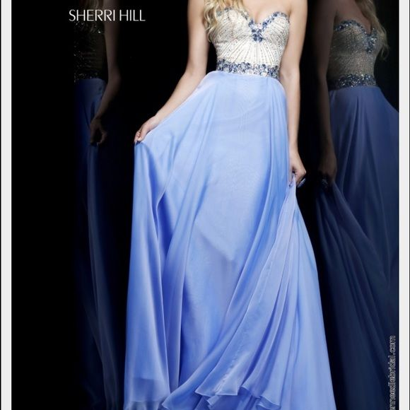 Sherri Hill #1923 Prom Dress !!PRICE REDUCED!! Nude bodice covered in crystals with periwinkles blue bottom. Cups sewn into bodice and only worn once. Perfect condition!! Got compliments from everyone at prom, a stunning and classic gown! Sherri Hill Dresses Strapless