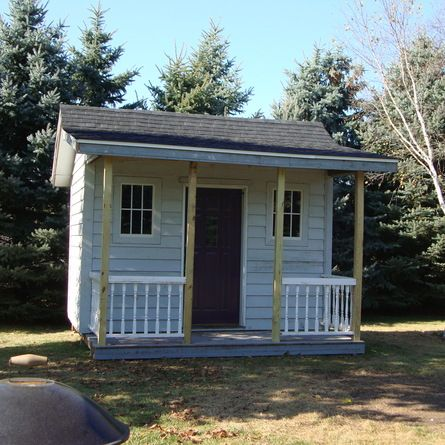 This cute 12' x 8' cedar-sided shed with 12' x 4' covered porch was built almost entirely with castoff materials for less than $200. | thisoldhouse.com/yourTOH