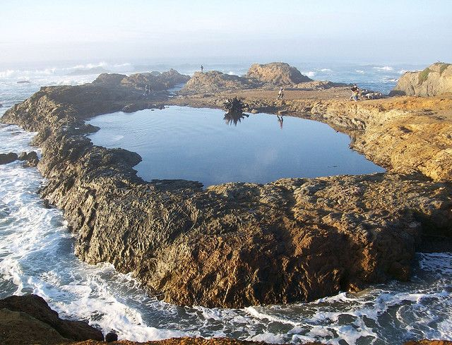 Tidal pool isolated from the waves of the Pacific Ocean by the ebb of the tides, at Glass Beach, outside Fort Bragg, California (glassbeach05xy) by mlhradio, via Flickr