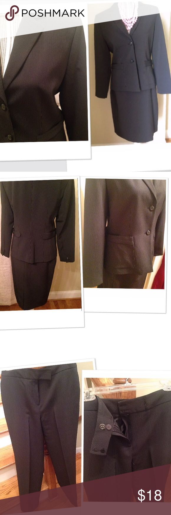 3 piece suit black pinstripes NWT This suit is brand new.  The pants and skirt  measure 30 inches in the waist and 30 inches long .  The suit is black with white pinstripes ships fast.  Comes from a smoke free and pet free home.  Thanks for viewing.. pret a porter Pants