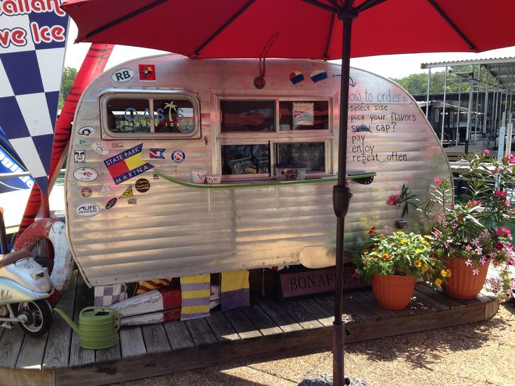 Snow cone stand. Vintage trailer. State park marina. Table
