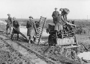 WWI, 10 Nov 1916, Somme, Battle of the Ancre; British troops unloading duckboards between Pozieres and Mouquet Farm. ©IWM