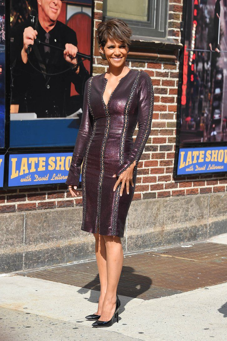 Pin for Later: 20 Reasons Halle Berry Is the Hottest 50-Year-Old We Know  This is what she looks like in a formfitting long-sleeved dress with a metallic sheen and peekaboo details.