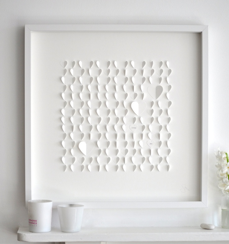 I like these framed pieces by Sarah & Bendrix.  This one is paper hearts. http://cococozy.com: Wall Art, Cards Stockings, Heart Large, Personalized White, Contemporary Artworks, White Heart, Paper Heart, Wedding Anniversaries, Frames Art